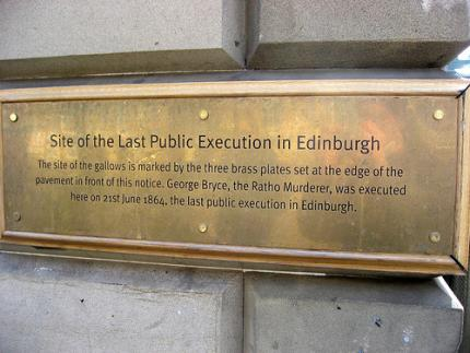 The plaque on the High Street.