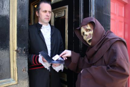 The Mad Monk presents his calling-card to the servant